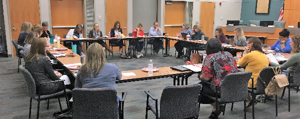 Photograph of a meeting of the special services advisory committee.